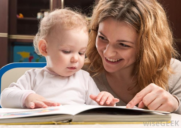http://images.wisegeek.com/mother-and-baby-looking-at-book.jpg